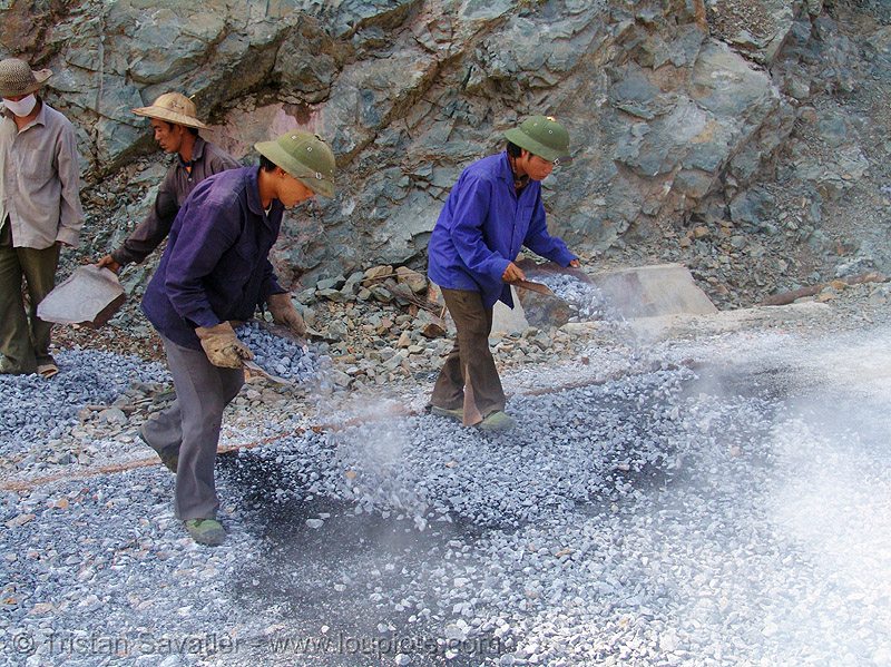 road paving - spraying gravel over hot asphalt - vietnam, gravel, groundwork, hot asphalt, hot bitumen, men, pavement, paving, road construction, roadworks, smoke, smoking, vietnam, workers, working