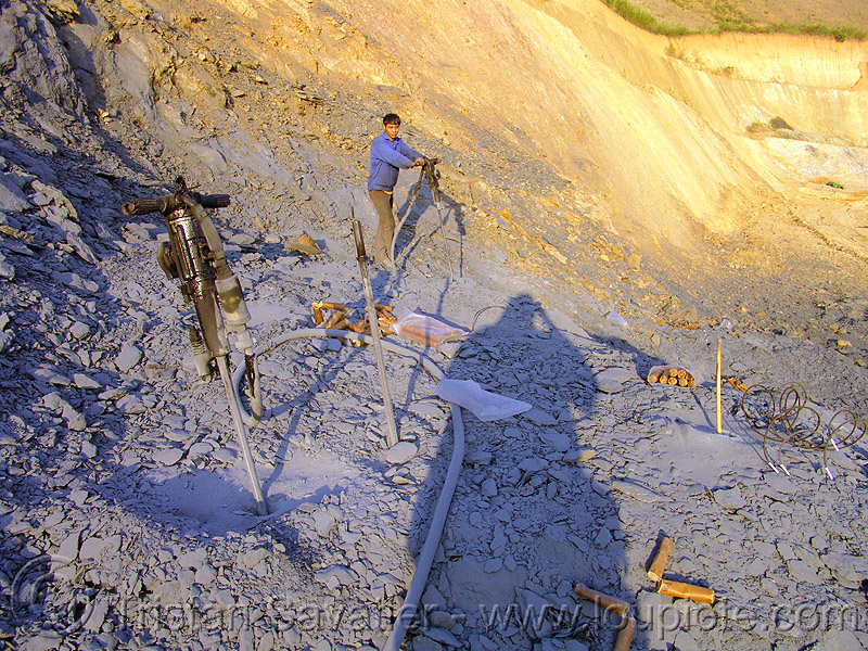 rock blasting with dynamite - road construction - vietnam, blasting caps, blasting charges, drilling and blasting, dynamite blasting, explosive, fuses, fuzes, groundwork, road construction, roadworks, rock blasting