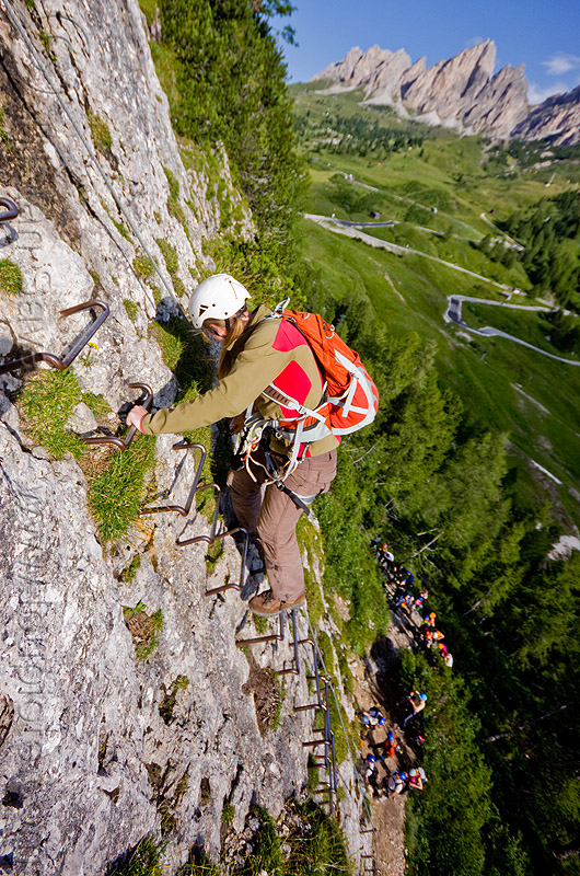 rock climber on cliff ladder, alps, cliff, climber, climbing harness, climbing helmet, dolomites, dolomiti, ferrata tridentina, ladder, mountain climbing, mountaineer, mountaineering, mountains, rock climbing, vertical, via ferrata brigata tridentina, woman