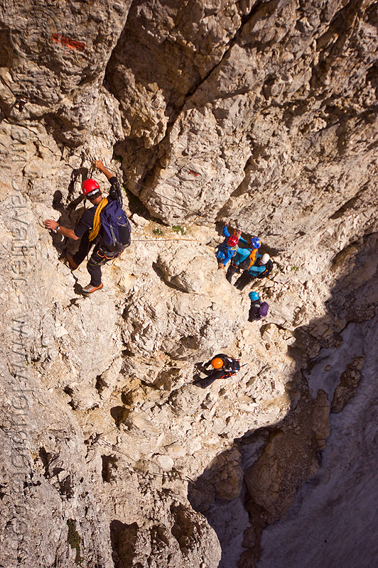 rock climbers on the passo santner via ferrata in the dolomites, alps, climbers, climbing helmet, dolomites, dolomiti, ferrata santner, mountain climbing, mountaineer, mountaineering, mountains, old snow, rock climbing, via ferrata del passo santner