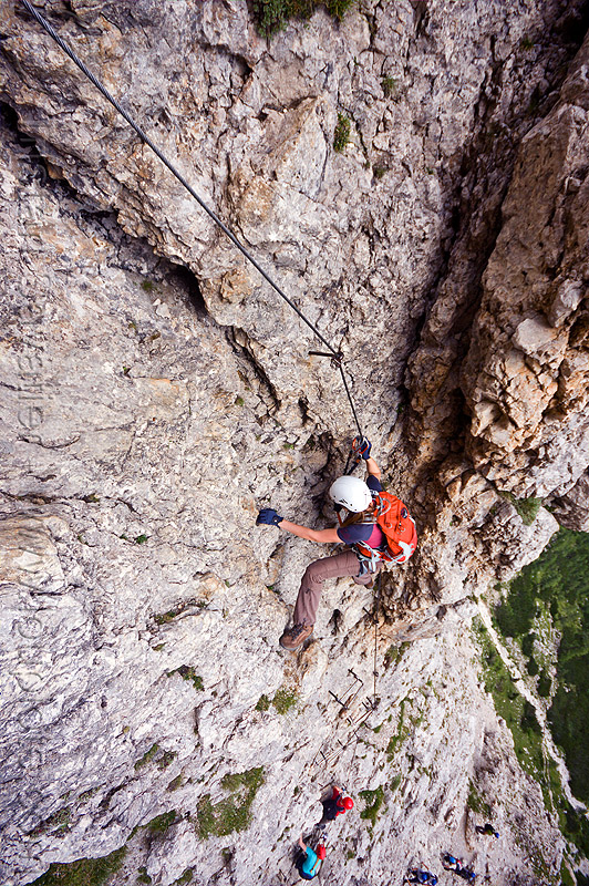rock climbing in the dolomites - via ferrata, alps, cliff, climber, climbing harness, climbing helmet, dolomites, dolomiti, ferrata tridentina, mountain climbing, mountaineer, mountaineering, mountains, rock climbing, vertical, via ferrata brigata tridentina, woman