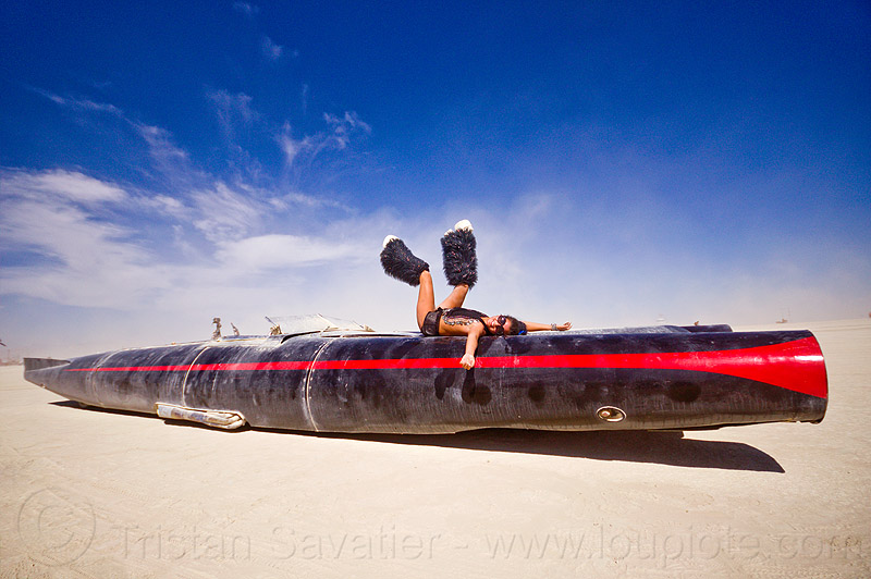 rocket car - burning man 2012, art car, black leg warmers, burning man, furry leg warmers, long, mutant vehicles, rocket car, woman