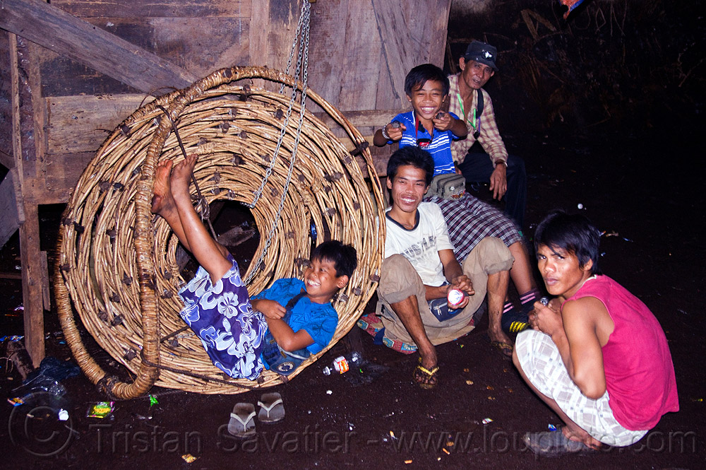 rolled rattan ladder - bird's nests collectors - madai cave (borneo), bird's nest, birds nest collectors, birds nest gatherers, caving, gua madai, ida'an, idahan, madai caves, men, natural cave, people, resting, rope ladder, spelunking