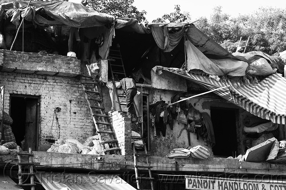 roofs of dilapidated shops, attic, building, climbing, cotton stores, delhi, dilapidated, handloom store, india, khurana handloom & cotton store, man, paharganj, pandit handloom & cotton store, roof, shelters, wooden ladders