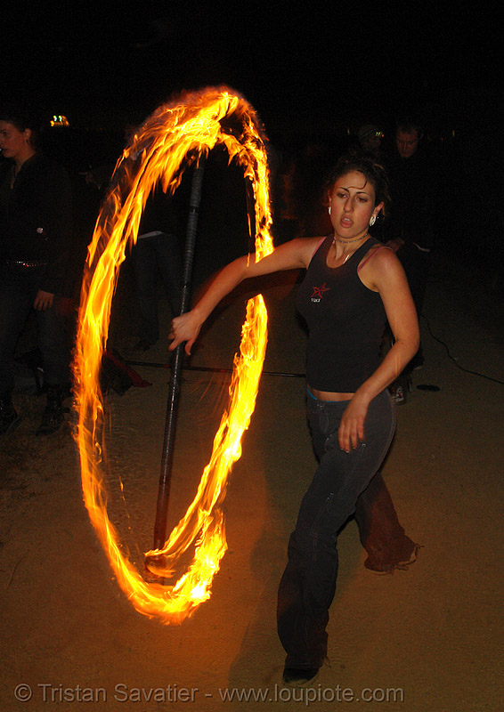 roxy spinning a fire staff, fire dancer, fire dancing, fire performer, fire spinning, flames, long exposure, night, people, spinning fire
