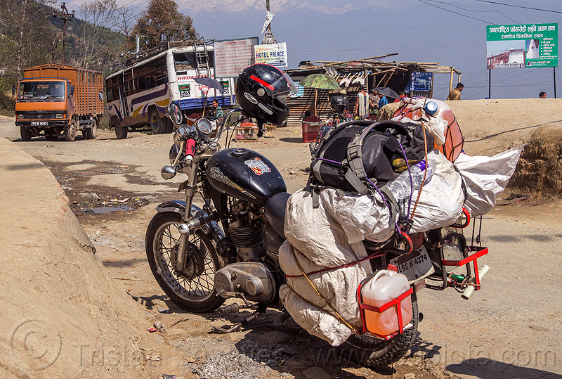 royal enfield bullet motorcycle loaded with luggage on rack (nepal), 350cc, bags, gas, gasoline, helmet, jerrycans, motorbike, motorbike touring, motorcycle touring, road, thunderbird