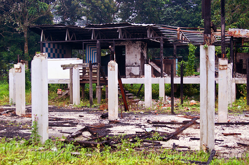 ruins of batu bungan village, batu bungan penan, burned down, columns, concrete, destroyed, destruction, gunung mulu, gunung mulu national park, houses, longhouse, pillars