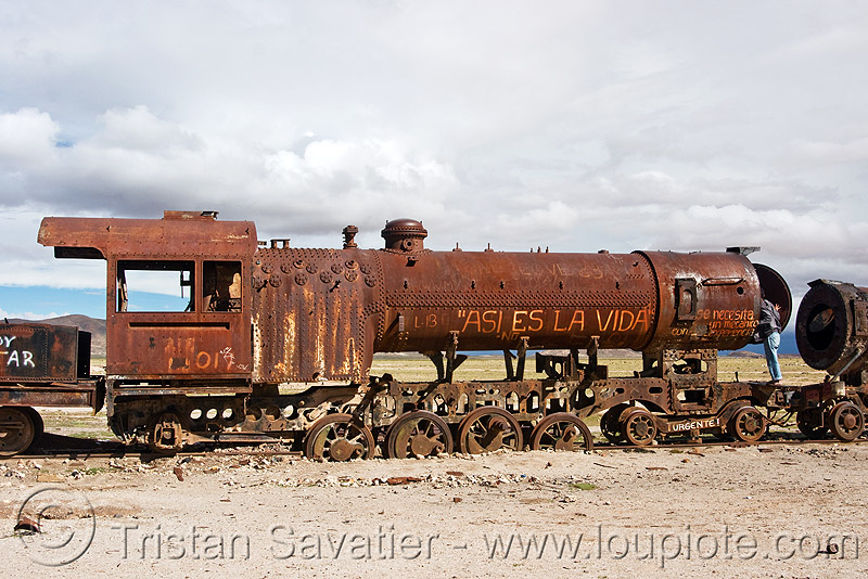 rusty steam locomotive  - train junkyard, abandoned, enfe, fca, people, railroad, railway, rusted, scrapyard, steam engine, steam train engine, train cemetery, train graveyard, uyuni