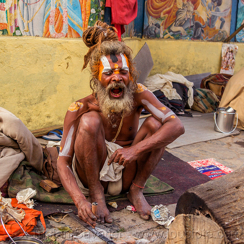 sadhu at the shivaratri hindu festival (nepal), baba, beard, cannabis, chillum, dreadlocks, dreads, festival, hindu, hinduism, kathmandu, knotted hair, maha shivaratri, man, marijuana, pashupati, pashupatinath, sadhu, screaming, smoking, squatting, tilak, tilaka