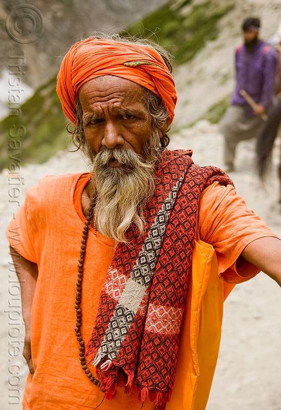 sadhu (hindu holy man) - amarnath yatra (pilgrimage) - kashmir, amarnath yatra, baba, beard, bhagwa, hiking, hindu holy man, hindu pilgrimage, hinduism, india, kashmir, mountain trail, mountains, old man, pilgrim, sadhu, saffron color, trekking
