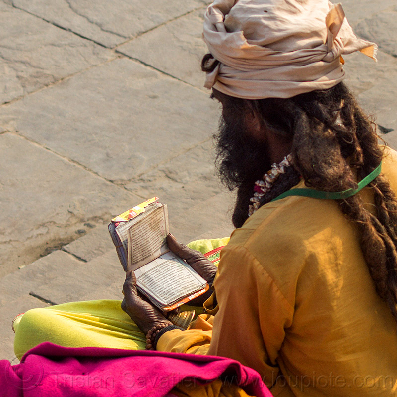 sadhu (hindu holy man) reading small book (india), baba, dreadlocks, ghats, headdress, hindi, hindu, hinduism, holy book, india, man, reading, sadhu, scriptures, sitting, turban, varanasi
