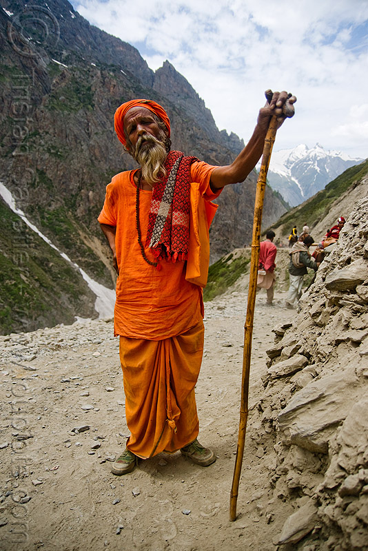 sadhu (hindu holy man) with cane on trail - amarnath yatra (pilgrimage) - kashmir, baba, beard, hiking cane, hinduism, mountain trail, mountains, old man, people, pilgrim, trekking, walking stick, yatris, अमरनाथ गुफा