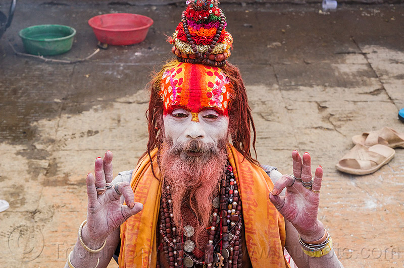 sadhu (hindu holy man) with large red tilaka with polka dots (nepal), baba, beard, dreadlocks, hindu, hinduism, holy ash, kathmandu, knotted hair, maha shivaratri, man, necklaces, pashupatinath, polka dots, red, rudraksha beads, sacred ash, sadhu, vibhuti
