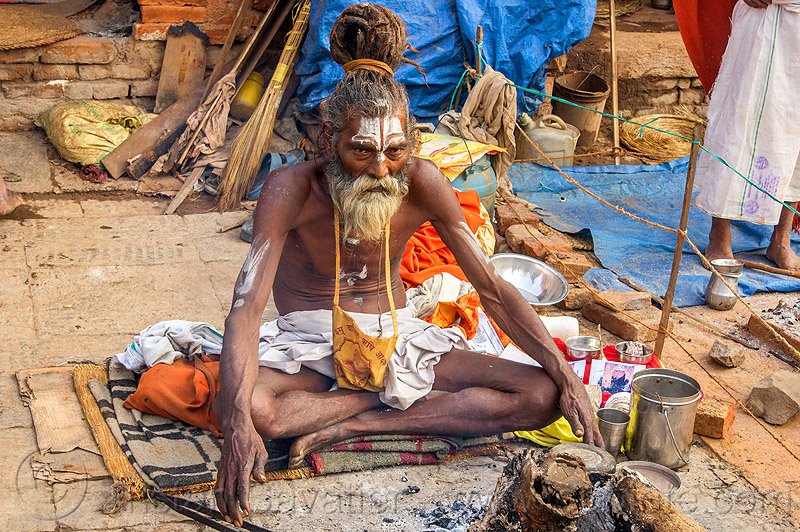 sadhu sitting cross-legged with threatening eyes (nepal), baba, beard, bonfire, dreads, festival, hindu, hinduism, kathmandu, knotted hair, maha shivaratri, man, pashupati, pashupatinath, people, tilak, tilaka