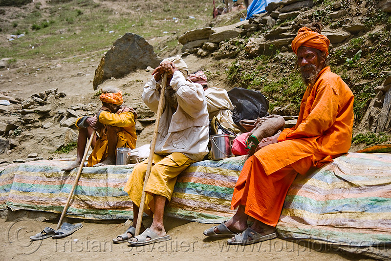sadhus (hindu holy men) resting on trail - amarnath yatra (pilgrimage) - amarnath yatra (pilgrimage) - kashmir, babas, canes, hiking canes, hinduism, man, mountain trail, mountains, people, pilgrims, trekking, walking sticks, yatris, अमरनाथ गुफा