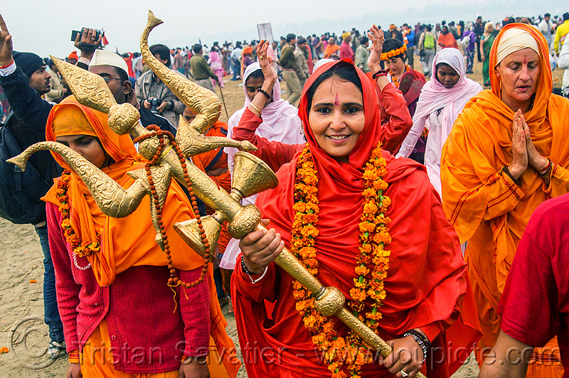 sadhvi (female hindu sadhu) at the kumbh mela 2013 festival (india), crowd, golden, hindu, hinduism, kumbha mela, maha kumbh mela, man, trident, vasant panchami snan, woman