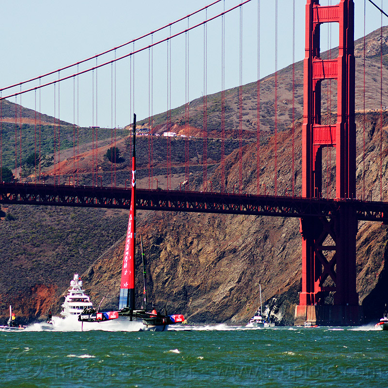 sailing hydrofoil catamaran emirates team new zealand near golden gate bridge - america's cup 2013 race (san francisco), ac72, america's cup, bay, boat, catamaran, emirates team new zealand, fast, foiling, golden gate bridge, hydrofoil catamarans, hydrofoiling, ocean, race, racing, sailboat, sailing hydrofoils, sea, ship, speed, suspension bridge, water