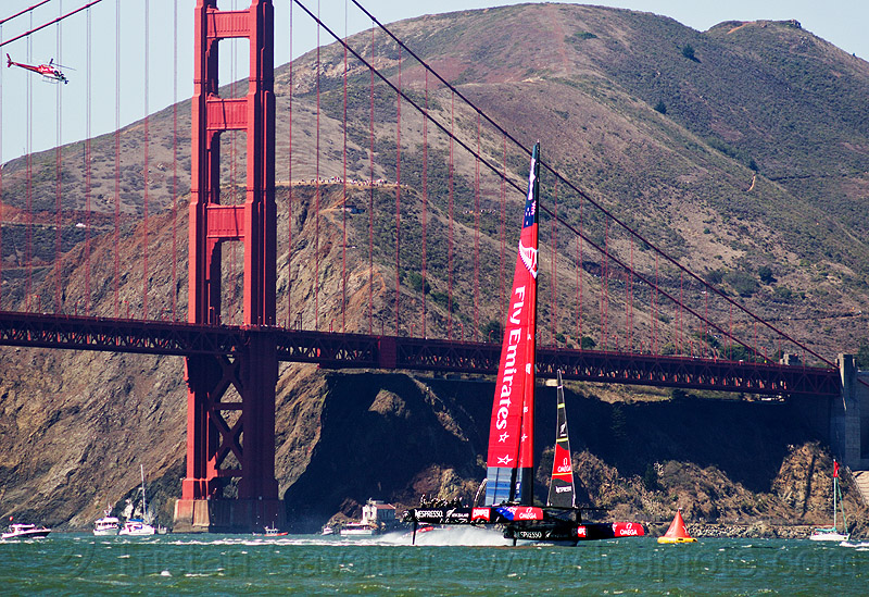 sailing hydrofoil catamaran emirates team new zealand near golden gate bridge - america's cup 2013 race (san francisco), ac72, advertising, america's cup, bay, boat, catamaran, emirates team new zealand, fast, foiling, golden gate bridge, helicopter, hydrofoil catamarans, hydrofoiling, ocean, race, racing, sailboat, sailing hydrofoils, sea, ship, speed, sponsors, suspension bridge, water