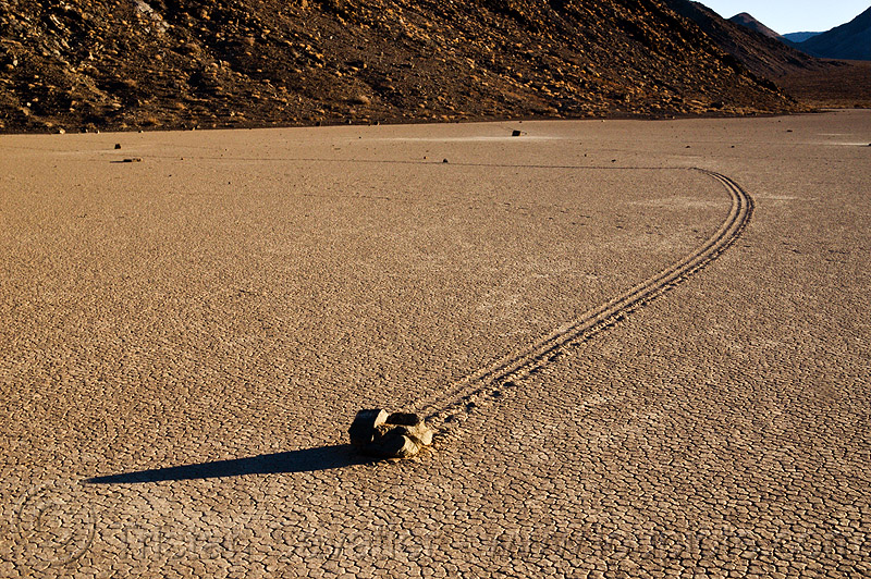 sailing stone on the racetrack - death valley, cracked mud, death valley, desert, dry lake, dry mud, mountains, moving rocks, racetrack playa, sailing stones, sliding rocks, tracks