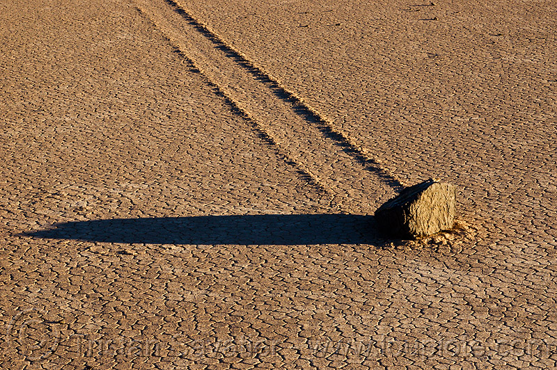 sailing stone on the racetrack - death valley, cracked mud, desert, dry lake, dry mud, moving, moving rock, playa, racetrack playa, sliding, sliding rock, track