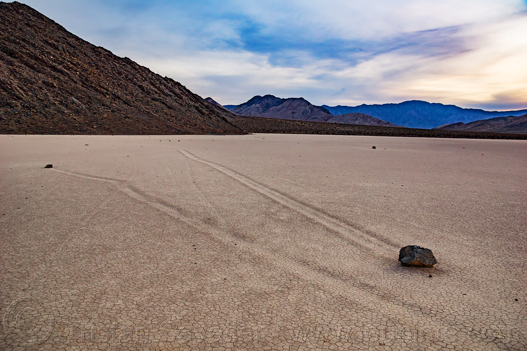 sailing stones on the racetrack - death valley, cracked mud, death valley, dry lake, dry mud, mountains, racetrack playa, sailing stones, sliding rocks