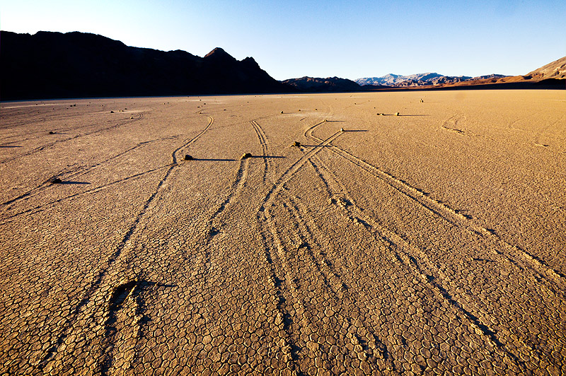 sailing stones on the racetrack - death valley, cracked mud, desert, dry lake, dry mud, mountains, moving, moving rocks, playa, racetrack playa, sliding, sliding rocks, tracks