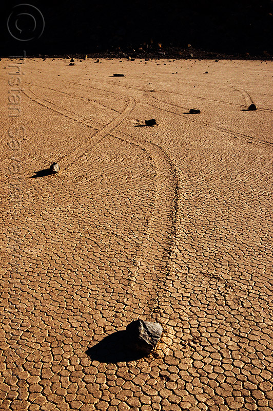 sailing stones on the racetrack - death valley, cracked mud, death valley, desert, dry lake, dry mud, racetrack playa, sailing stones, sliding rocks, tracks