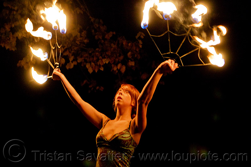samantha with fire fans (san francisco), fire dancer, fire dancing, fire performer, fire spinning, flames, night, people, red hair, redhead, sam, spinning fire, woman