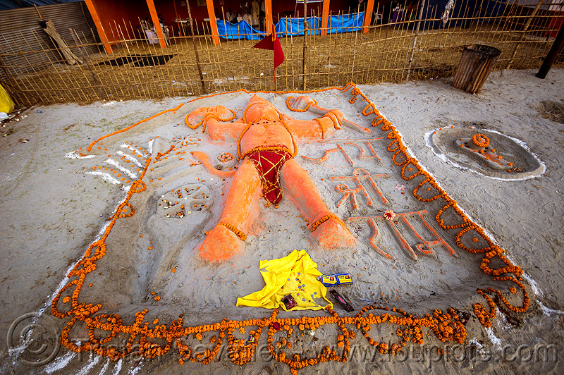 sand sculpture of hanuman (india), bhagwa, hanuman, hindu deity, hindu god, hinduism, kumbha mela, maha kumbh mela, marigold flowers, offerings, orange color, orange flowers, saffron color, sand altar, sand sculpture