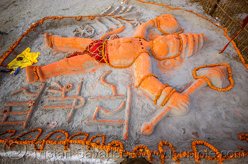 sand sculpture of hanuman (india), bhagwa, gadhai, hanuman, hindu deity, hindu god, hinduism, kumbha mela, maha kumbh mela, marigold flowers, offerings, orange color, orange flowers, saffron color, sand altar, sand sculpture