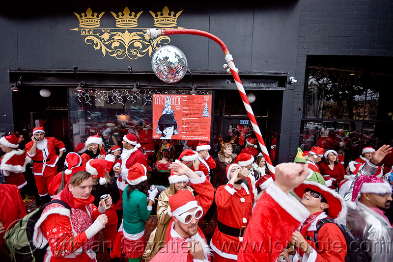 santacon 2009 - santa claus convention (san francisco), candy cane, christmas, costumes, crowd, disco ball, mirror ball, people, red, santarchy, santas, sugar cane, the triple crown