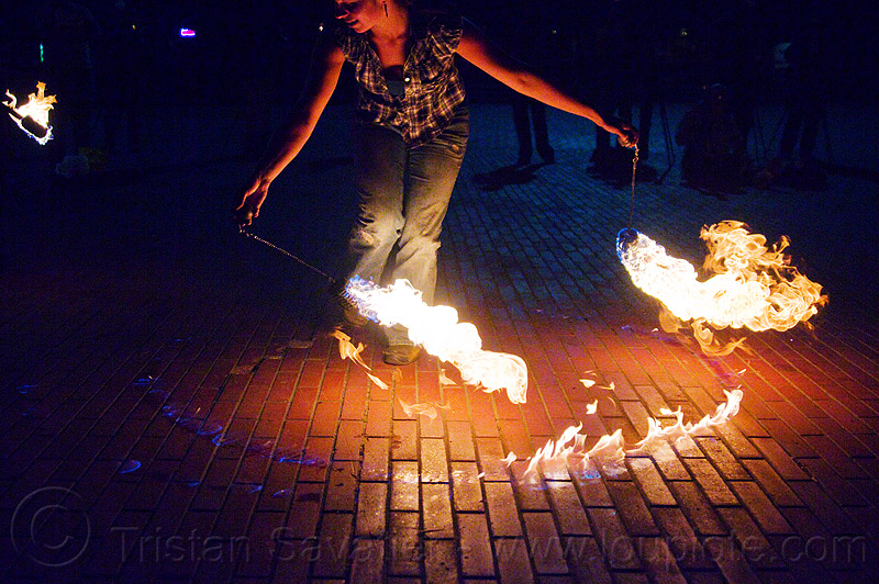 savanna spinning fire poi, fire dancer, fire dancing, fire spinning, flame, night, stock photo