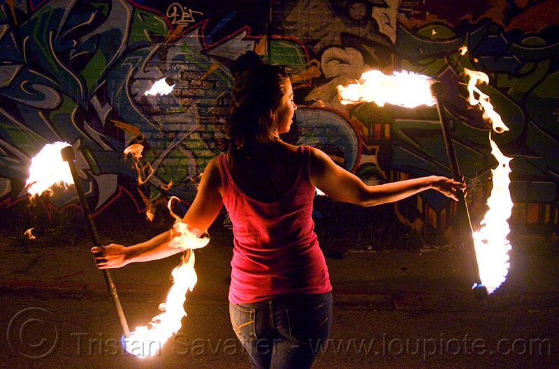 savanna spinning fire staffs, double staff, fire dancer, fire dancing, fire performer, fire spinning, fire staffs, fire staves, flame, graffiti, night, savanna, spinning fire, wall, woman