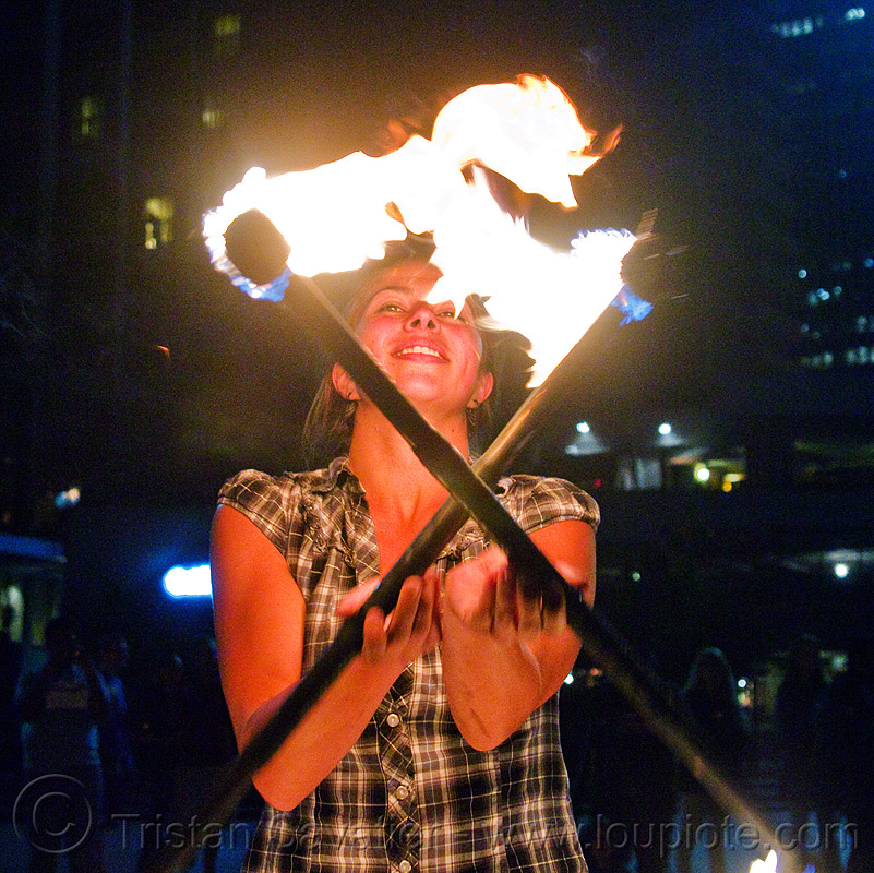 savanna spinning fire staffs, crossed, double staff, fire dancer, fire dancing, fire performer, fire spinning, fire staffs, fire staves, night, savanna, spinning fire, woman