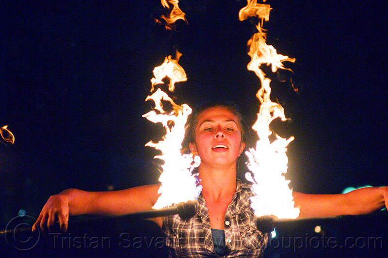 savanna spinning fire staffs, double staff, fire dancer, fire dancing, fire performer, fire spinning, fire staves, flames, night, woman