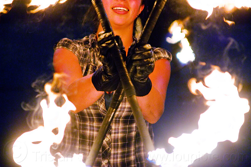savanna spinning fire staffs, crossed, double staff, fire dancer, fire dancing, fire performer, fire spinning, fire staffs, fire staves, leather gloves, night, savanna, spinning fire, woman