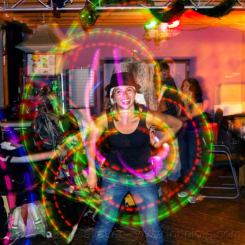 savanna spinning LED poi, flowtoys, glow poi, hat, light trails, long exposure, people, woman