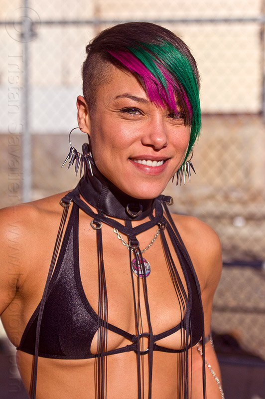 scanty black top with hanging strings, black outfit, burning man decompression, earrings, fashion, green and pink hair, identical twin, monique, people, pink and green hair, scanty top, spiky earrings, woman