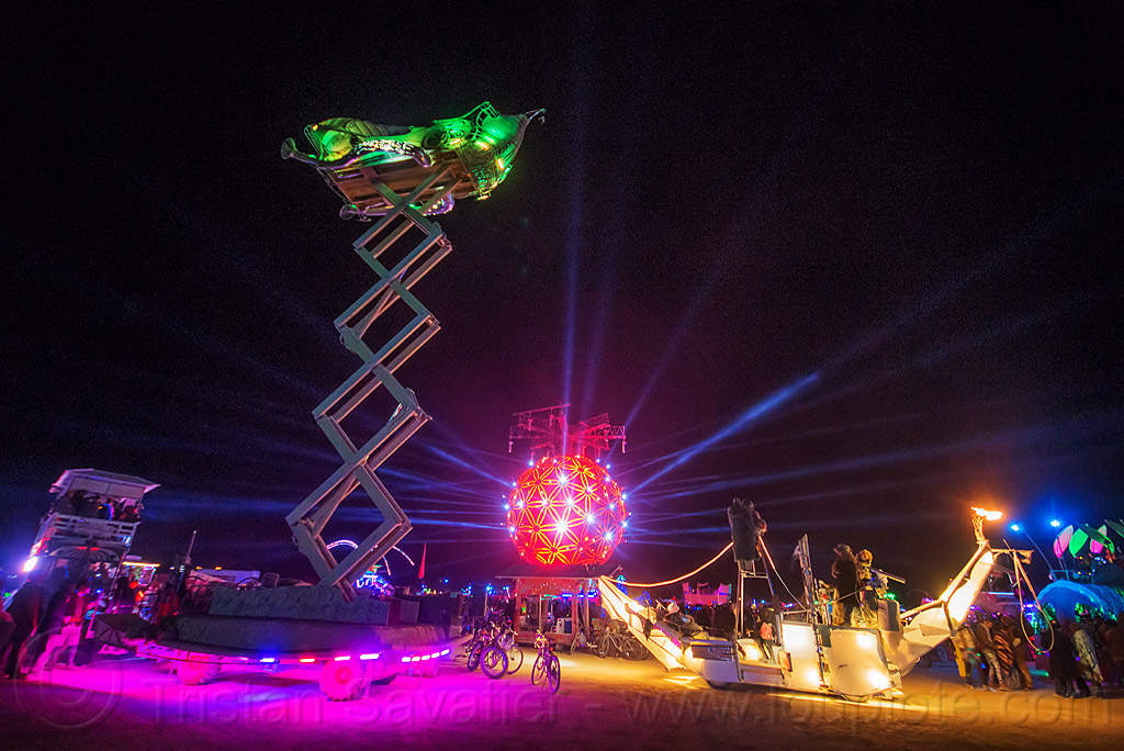 scissor lift art car at night - burning man 2015, boat, burning man, cherrypicker, crescent, elevator, fly me to the moon art car, glowing, hydraulic, night, scissor lift, ship, the ball, unidentified art car