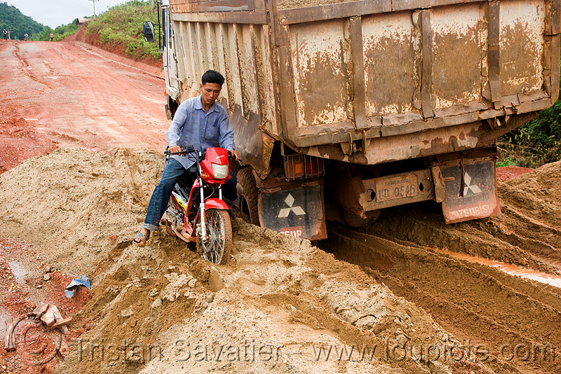 scooter and truck stuck in mud (laos), lorry, motorbike, mud, rider, riding, road, ruts, stuck, tracks, truck, underbone motorcycle