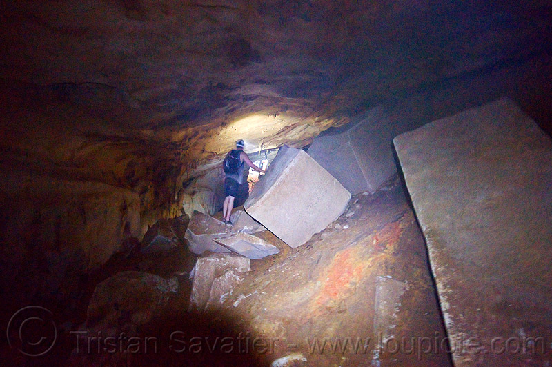scrambling around big blocks - caving in mulu (borneo), blocks, borneo, cavers, caving, clearwater cave system, clearwater connection, gunung mulu national park, malaysia, natural cave, spelunkers, spelunking