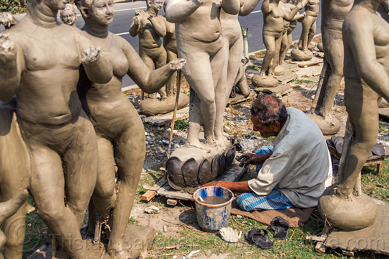 sculptor making clay sculptures on road side (india), bucket, clay, india, man, sculptor, sculptures, statues, west bengal, working