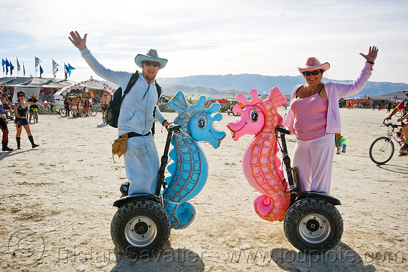 seahorses segway lovers, blue, burning man, couple, hats, inflatables, love, pink, seahorses, segway x2, segways, woman