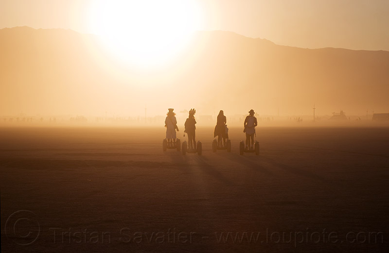 segways - burning man 2012, backlight, burning man, haze, hazy, segway x2, segways, silhouettes