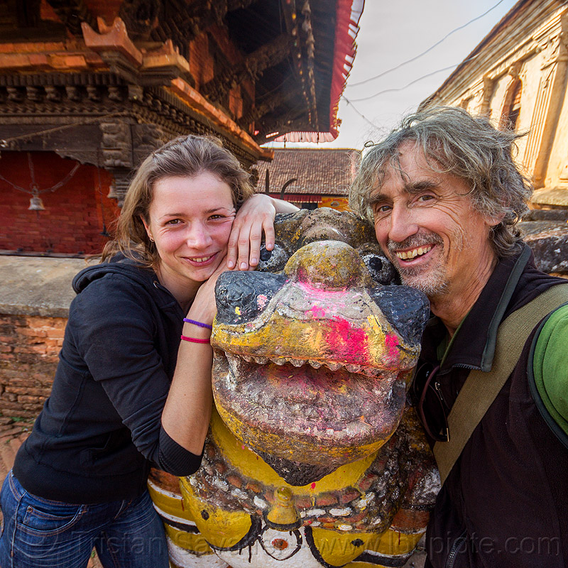 selfie with anne-laure and a colorful stone lion, anne-laure, hindu temple, hinduism, man, nuwakot durbar, saat taale durbar, sculpture, self-portrait, selfie, statue, stone lion, woman