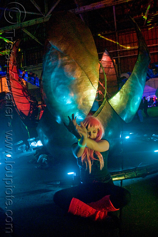 serpent mother's egg - giant snake skeleton animated sculpture - opulent temple massive rave party (treasure island, san francisco), art installation, egg, flaming lotus girls, giant, night, opulent temple, pink wig, sculpture, serpent mother, skeleton, snake, woman