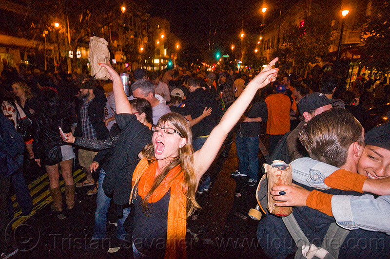 SF giants fans celebrating, 2012 world series, alcohol, baseball fans, beer, celebration, crowd, editorial, go giants, night, paper bags, party, partying, people, sports fans, street party, woman