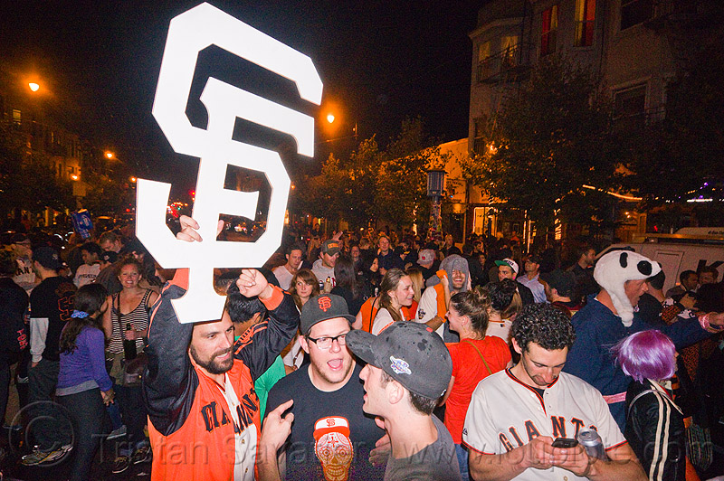 SF giants fans celebrating, 2012 world series, baseball fans, celebrating, celebration, crowd, editorial, go giants, night, partying, sf giants logo, sports fans, street party