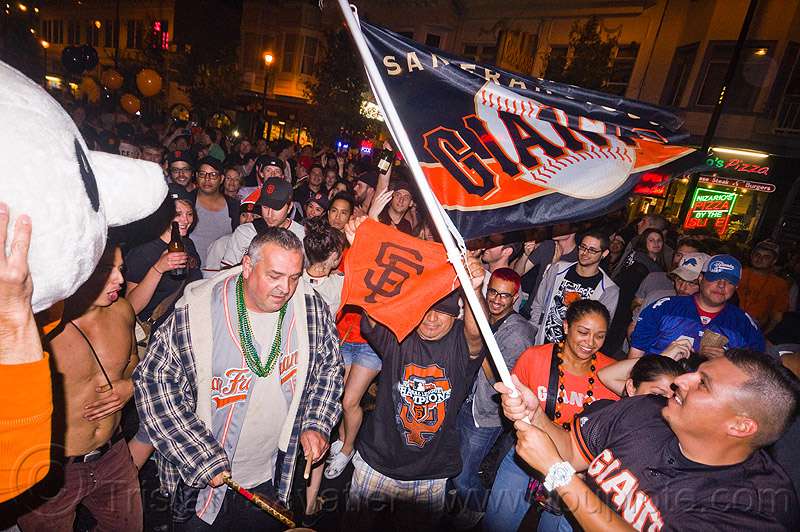 SF giants fans celebrating, 2012 world series, baseball fans, celebration, crowd, editorial, flag, go giants, night, party, partying, people, sports fans, street party