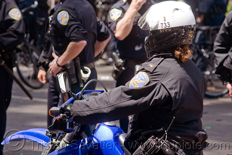 SFPD motorcycle riot police at the bay to breakers (san francisco), bay to breakers, crack-down, festival, law enforcement, motorbike, motorcycle unit, rider, riding, riot police, sfpd, street party, uniform, woman